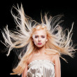 Stock Photo: Fashion Portrait of beautiful blonde with flying hair