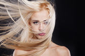 Fashion Portrait of beautiful blonde with the flying hair — Stock Photo