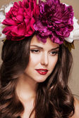 Sexy beautiful woman with bright flowers on her head — Stock Photo