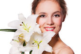 Beauty portrait of a beautiful girl with fresh flower lily. isolated on white — Stock Photo