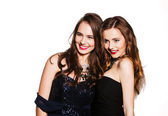 Two women in cocktail dresses — Stock Photo