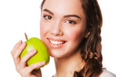 Smiling beauty holding green apple while isolated on white — Stock Photo
