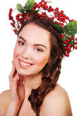 Beautiful girl with a wreath of berries. woman smiling face — Stok fotoğraf
