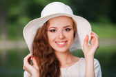 Woman wearing  straw hat — Stock Photo
