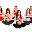 Group of six smiling pregnant women doing yoga. isolated on white — Stock Photo #49933627
