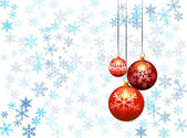 Three christmas balls on snow flakes background — Stockvector