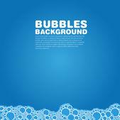 Banho de bolha de sabão sobre fundo azul — Fotografia Stock
