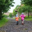 Kids walking in green village path — Stock Photo
