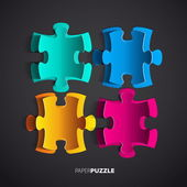 Puzzle quatre papier coloré — Vecteur