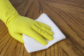 Gloved hand with paper towel — Stock Photo