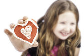 Young girl holding a heart cookie — Foto de Stock