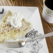 Coconut cream pie and coffee — Stock Photo