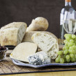Rustic bread with assorted cheeses - Stock Photo
