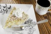 Coconut cream pie and coffee — Stock Photo