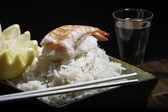 Shrimp sushi on a bowl of rice — Stock Photo