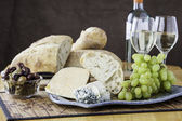 Rustic bread with assorted cheeses — Stock Photo