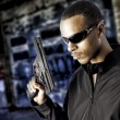 Stock Photo: Black male holding handgun
