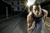 Young black male running in an urban setting — Stock Photo