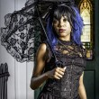 Sexy black gothic woman with parasol - Stok fotoğraf