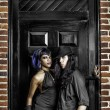 Gothic couple in front of door — Stock Photo