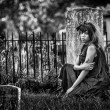 Beautiful black gothic woman in graveyard — Stock Photo