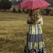 Young girl with umbrella — Stock Photo #19104303