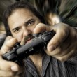 Isolated man with video game controller — Stock Photo