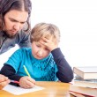 Father and son doing homework — Stock Photo #19104909