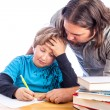 Father and son doing homework — Stockfoto