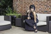 Sexy black gothic woman smoking — Stock Photo
