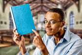 Nerdy black male with book — Stock Photo