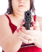 Woman with gun — Stock Photo