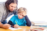 Father and son doing homework — Stok fotoğraf