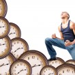 Man kneeling on clocks — Stock fotografie