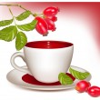 Cup of tea and ripe rose hip . — Vector de stock #33426881