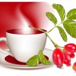 Cup of tea and ripe rose hip . — Stockvector