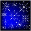 Snowflakes on blue background. — Imagens vectoriais em stock