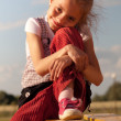 Portret of cute girl on the bench - Stock Photo