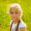Pretty girl on the nature of the grass - Stock Photo