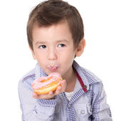 Boy eating a donut — Stock Photo