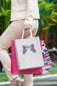 Asian woman and shopping bag — Stock Photo