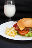 Hamburger and milk — Stock Photo