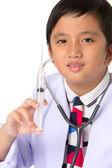 Boy holding a syringe — Stock Photo