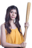 Girl holding a baseball bat. — Stockfoto
