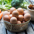 Stock Photo: Eggs in basket and vegetables