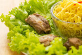 Noodles pork with lettuce — Stock Photo