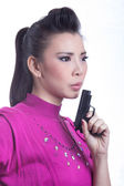 Woman aiming a gun — Stock Photo