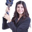 Asian woman holding angry ukulele in hand. — Stock Photo