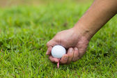 Hand hold golf ball — Stock Photo