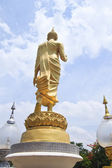 Walking Buddha statue — Stock Photo